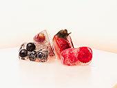 Berries frozen in ice cubes