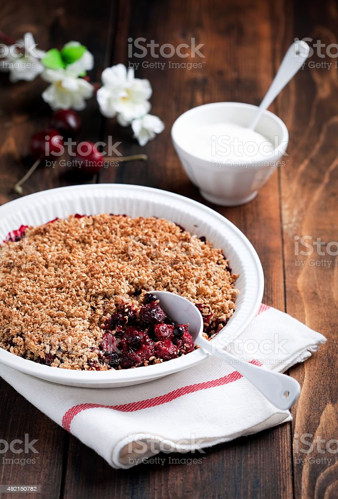 Berries, oat bran and flax seeds crumble stock photo