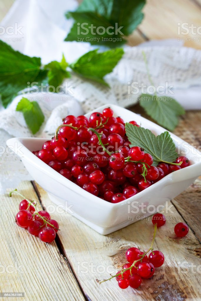 Berries of red currant on a wooden background. The concept of a healthy diet and diet. stock photo