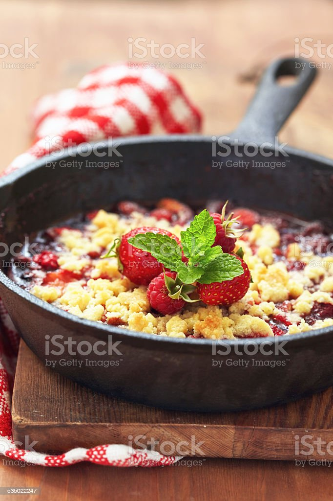Berry crumble with strawberry and raspberry stock photo