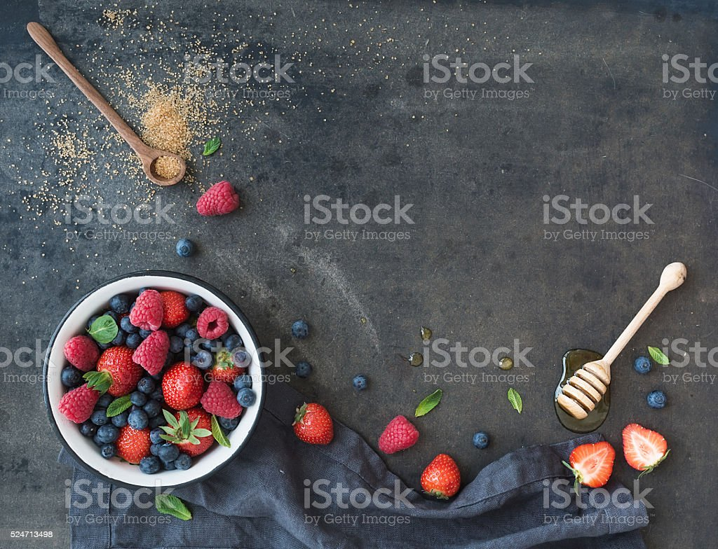 Berry frame with copy space on right. Strawberries, raspberries, blueberries stock photo