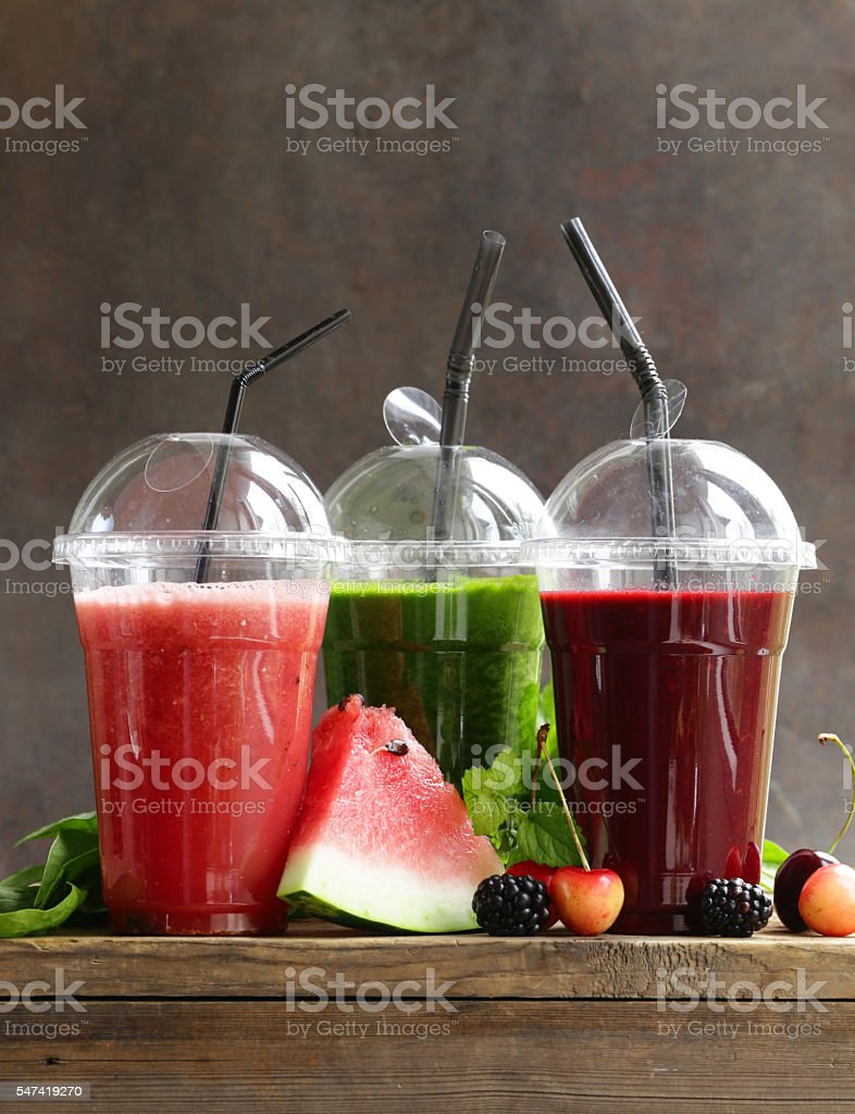 berry fruit and spinach drink smoothies with cherries, raspberry, watermelon stock photo