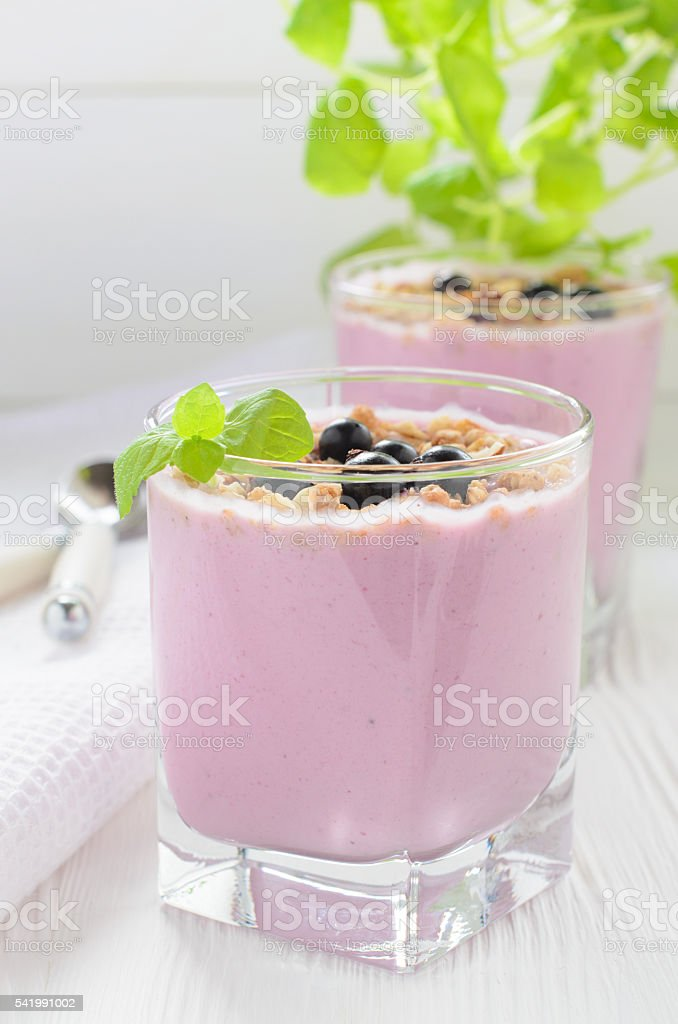 Berry milk smoothie with muesli stock photo