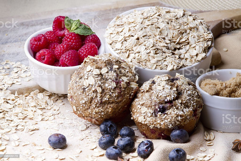 Berry Muffins Arranged with Fresh Ingredients stock photo
