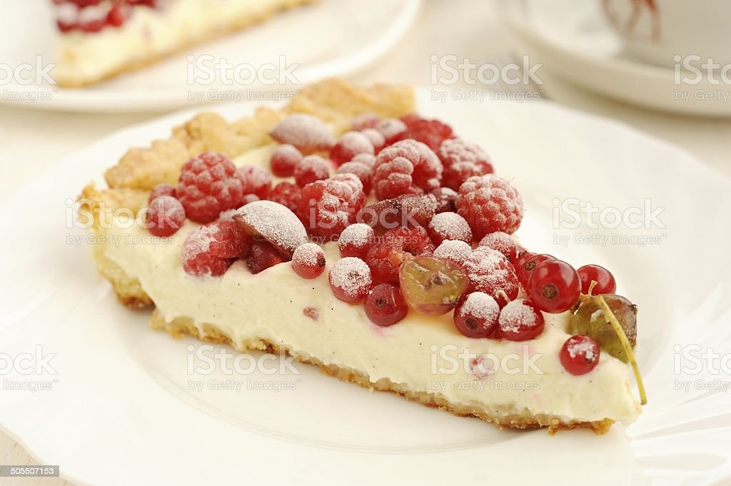 Berry pie with whipped cream filling close up stock photo