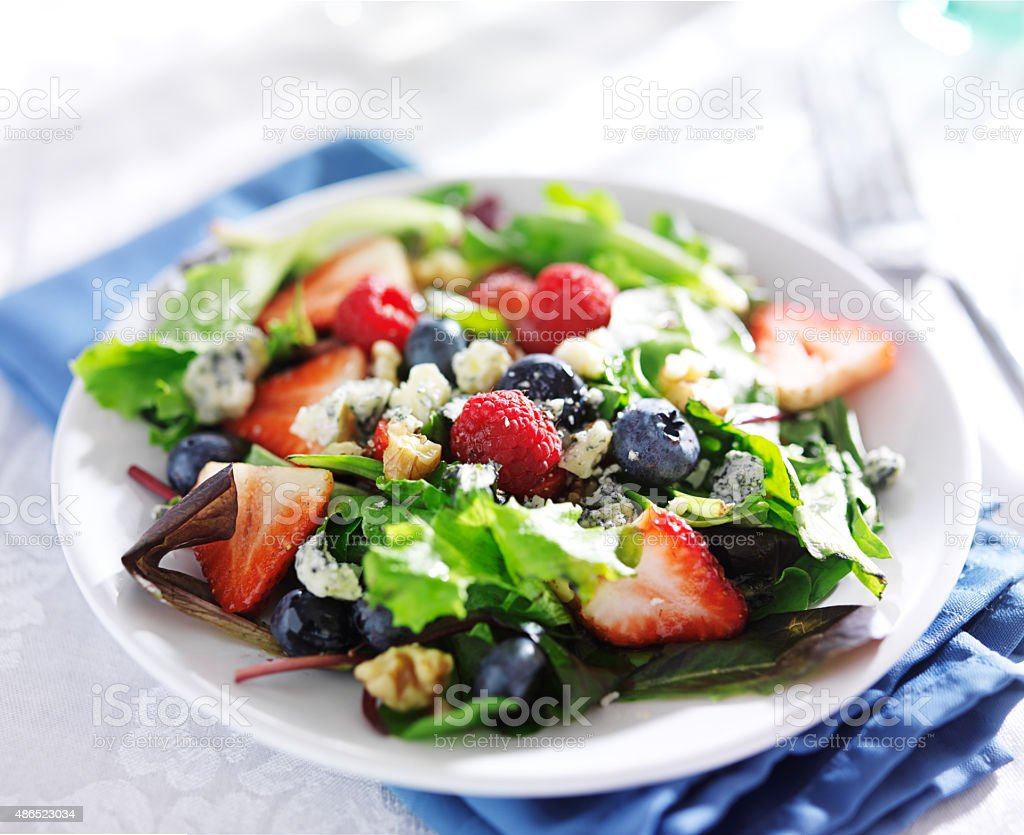 berry salad with walnuts and blue cheese stock photo