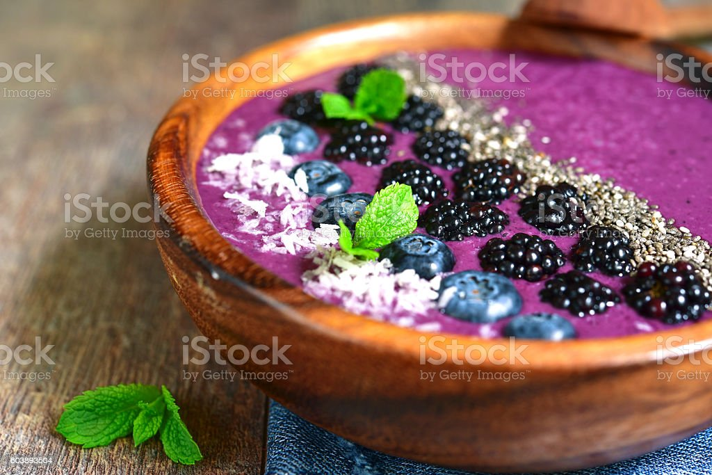 Berry smoothie in a wooden bowl.Top view. stock photo