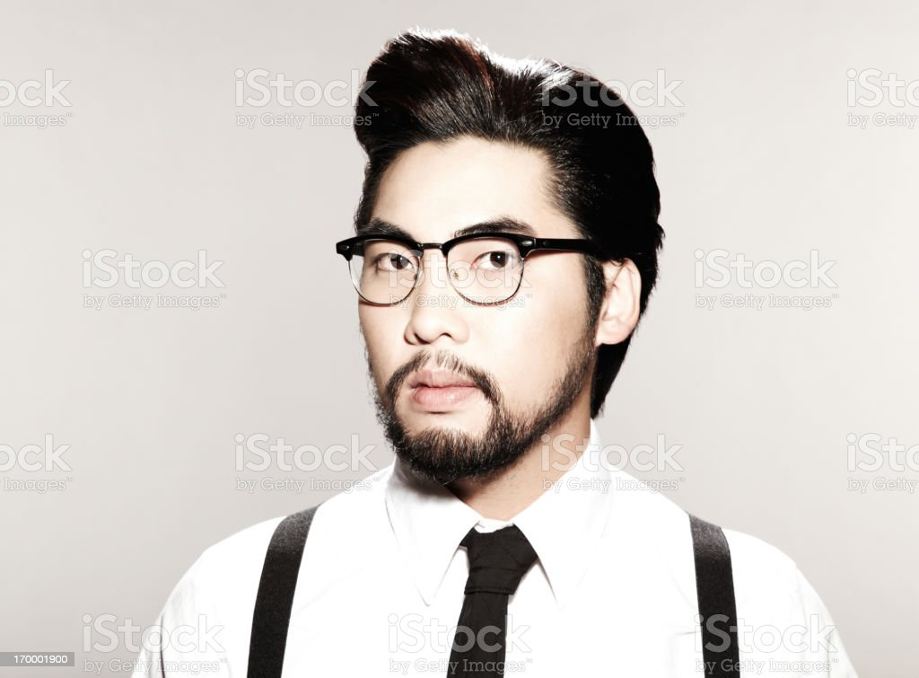 Bespectacled young male on off-white background stock photo