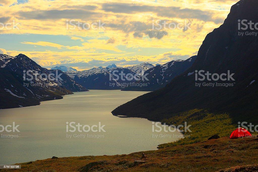 Besseggen, turquoise Lake Gjende sunset camping, Jotunheimen, Norway - Scandinavia stock photo