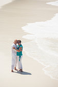 best ager couple hugging beach love happy