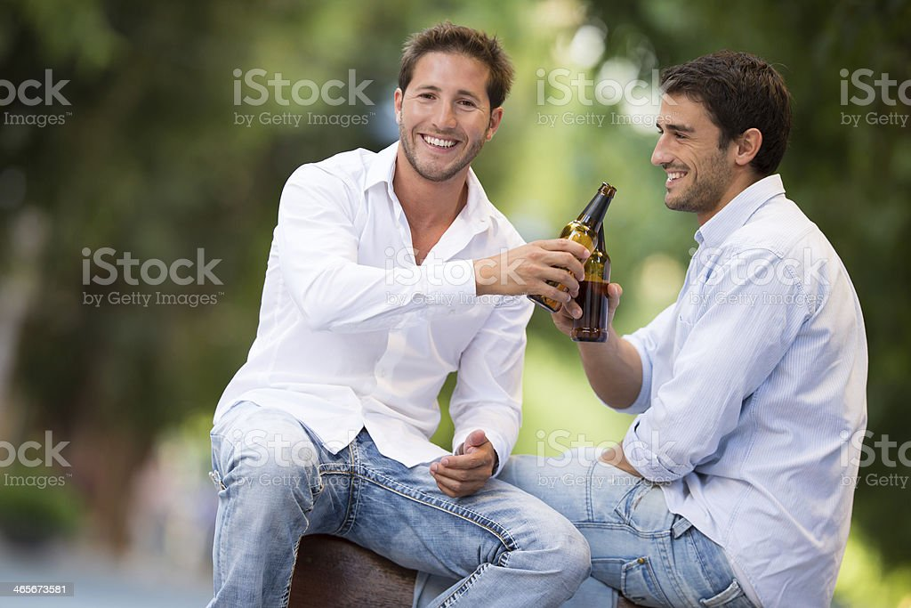 best friends drinking beer in the park royalty-free stock photo