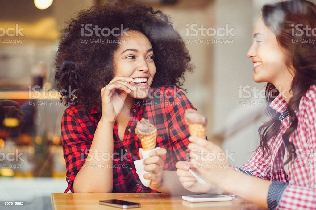 Best friends eating ice-cream stock photo