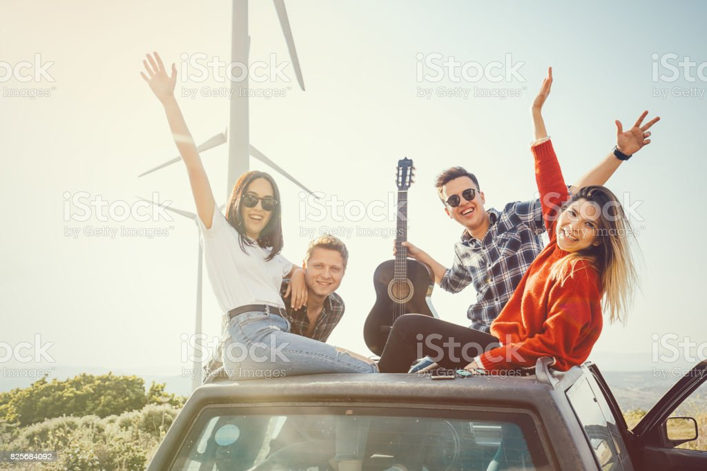 Best friends enjoying the outdoor party together with confetti in nature stock photo