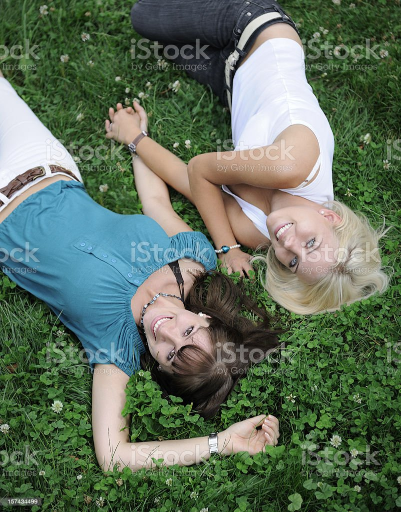 Best Friends enjoying themselves outdoor in the Meadow (XXXL) royalty-free stock photo
