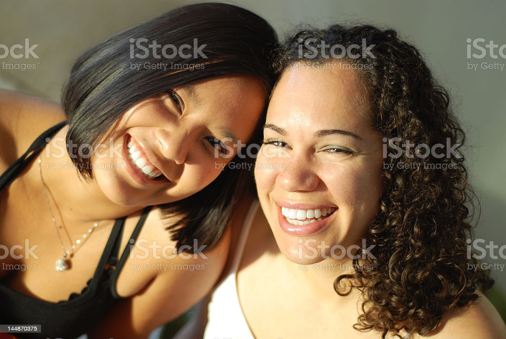 Best friends giggling stock photo