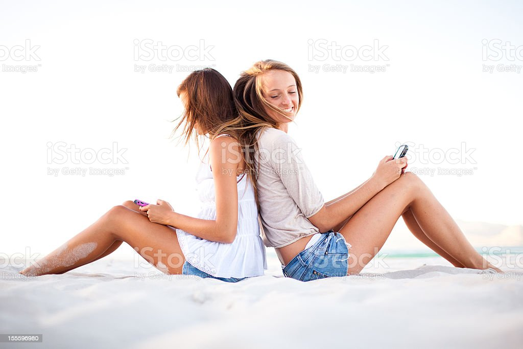 Best friends hanging out on the beach royalty-free stock photo