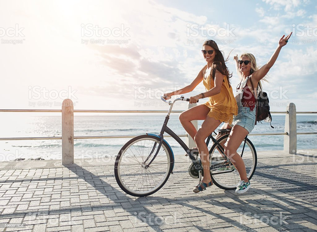 Best friends having fun on a bike stock photo