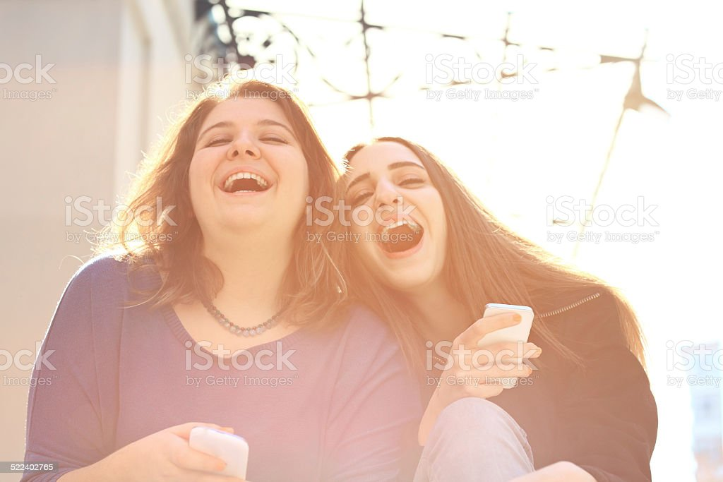 Best Friends Laughing in Street stock photo