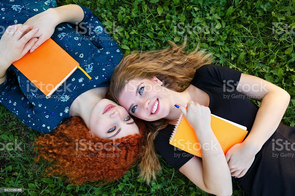 Best friends lie on the lawn. stock photo