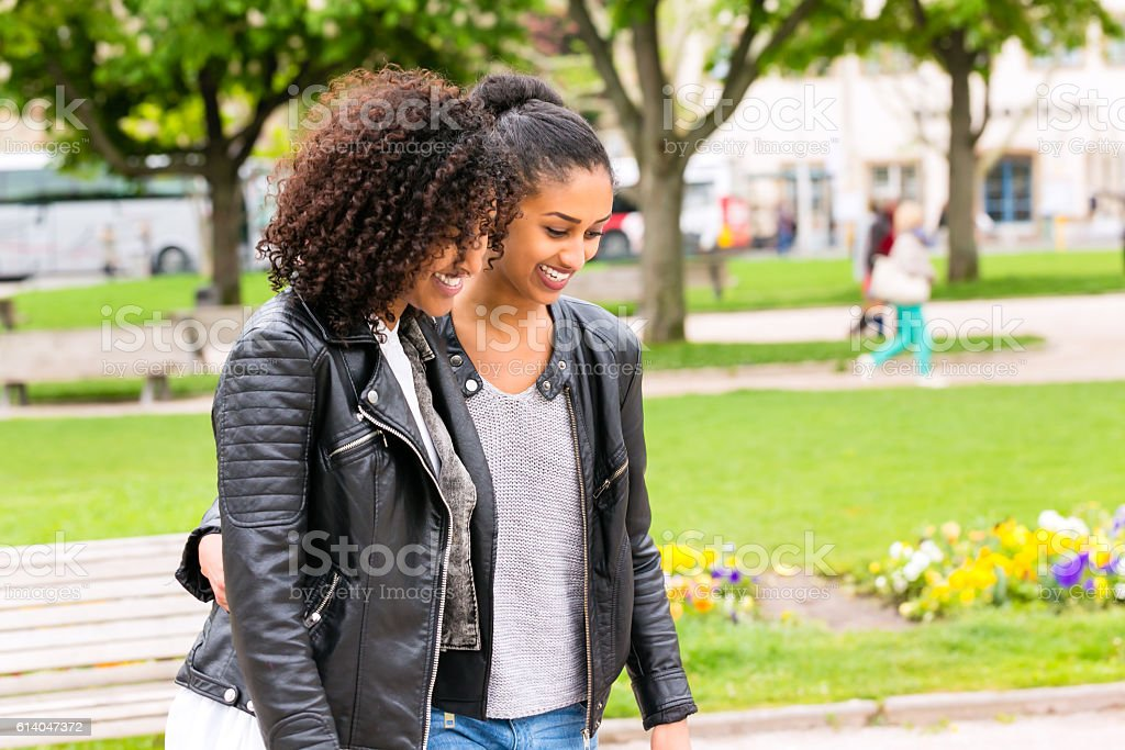 Best friends of north african ethnicity in park stock photo