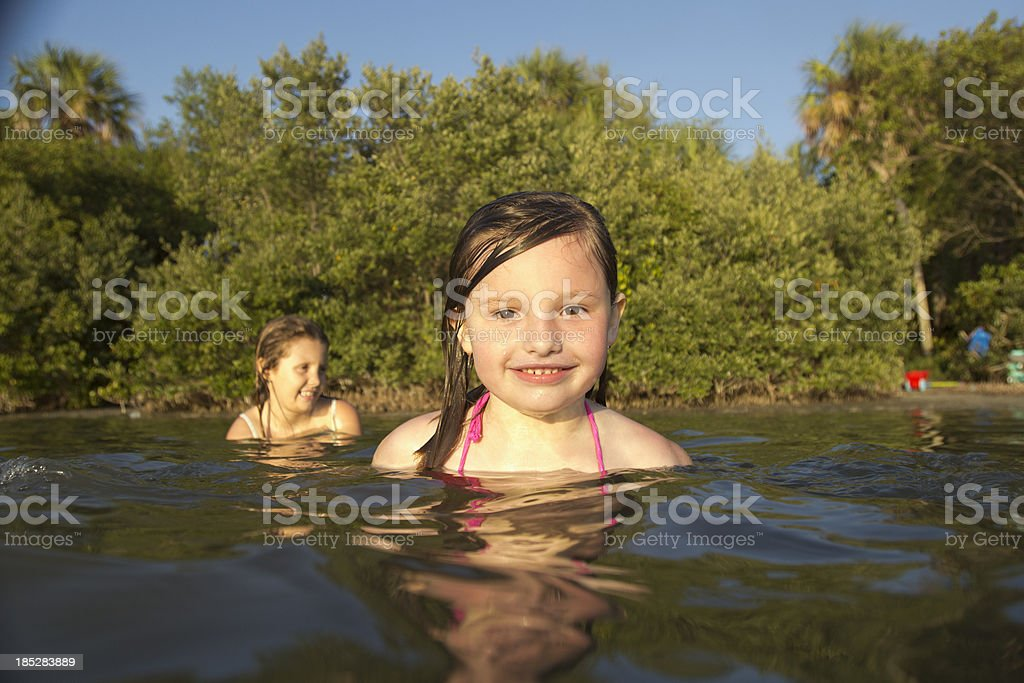 Best friends playing in the water royalty-free stock photo