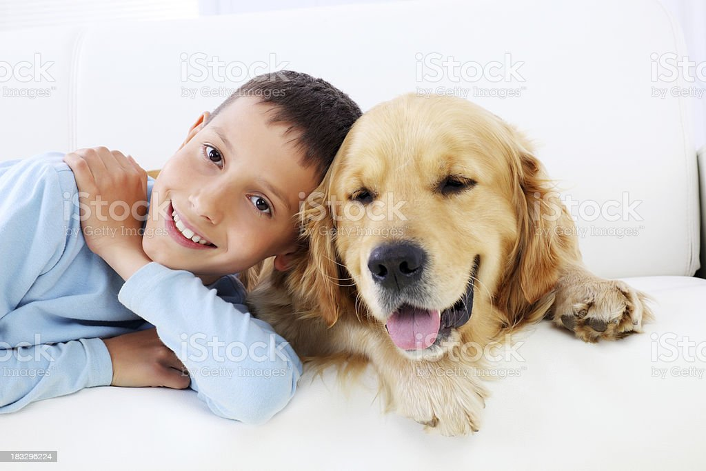 Best friends- smiling boy and dog. royalty-free stock photo