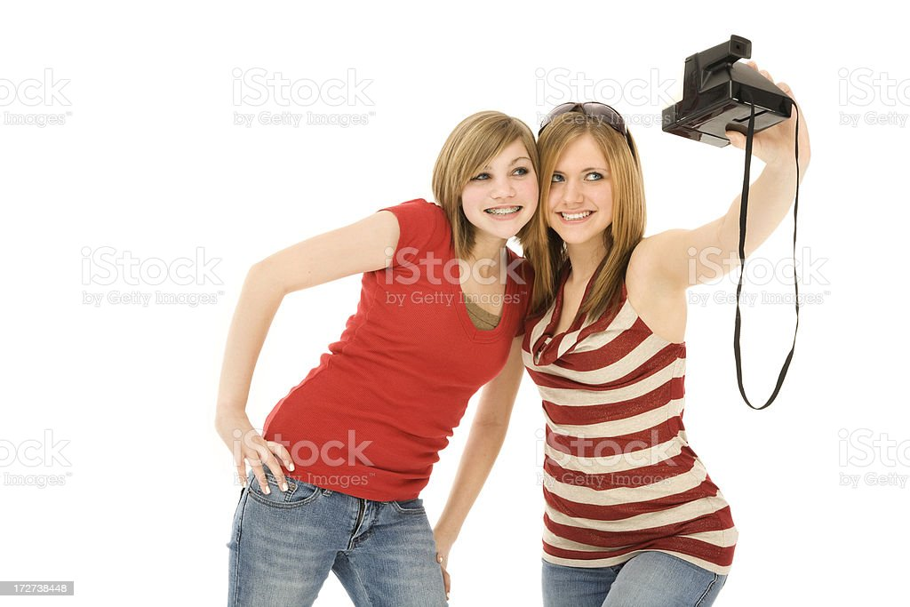 Best Friends Taking a Self Portrait with Instant Camera royalty-free stock photo