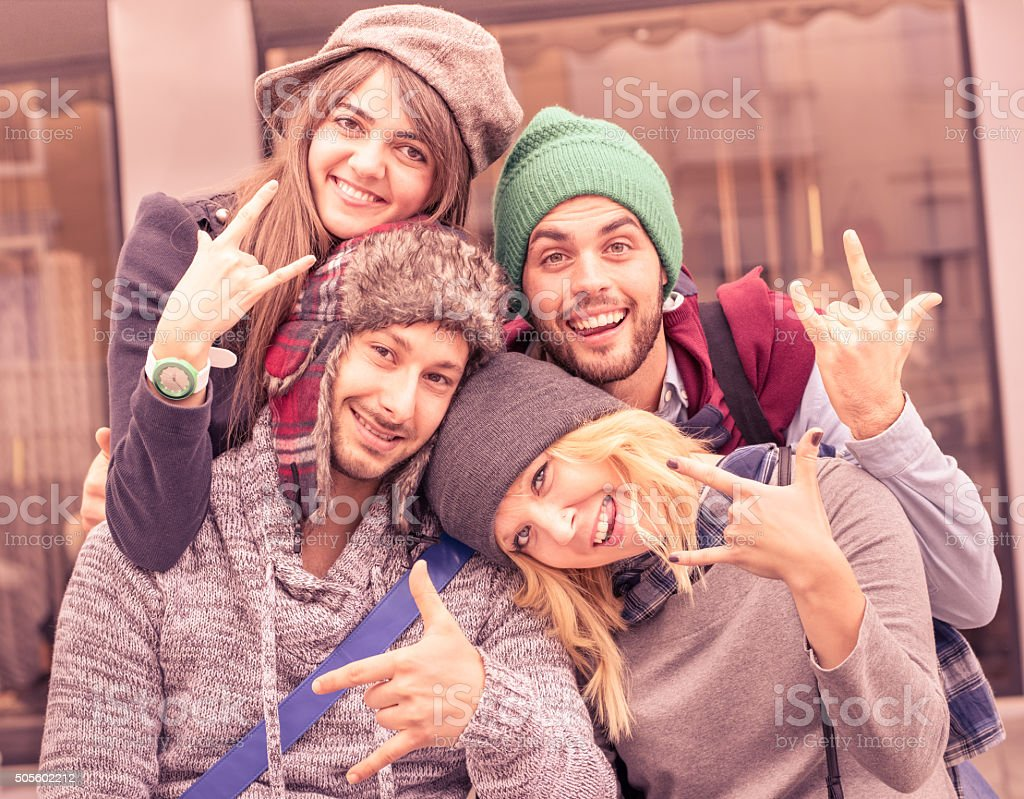 Best friends taking selfie outdoors with funny face expression stock photo