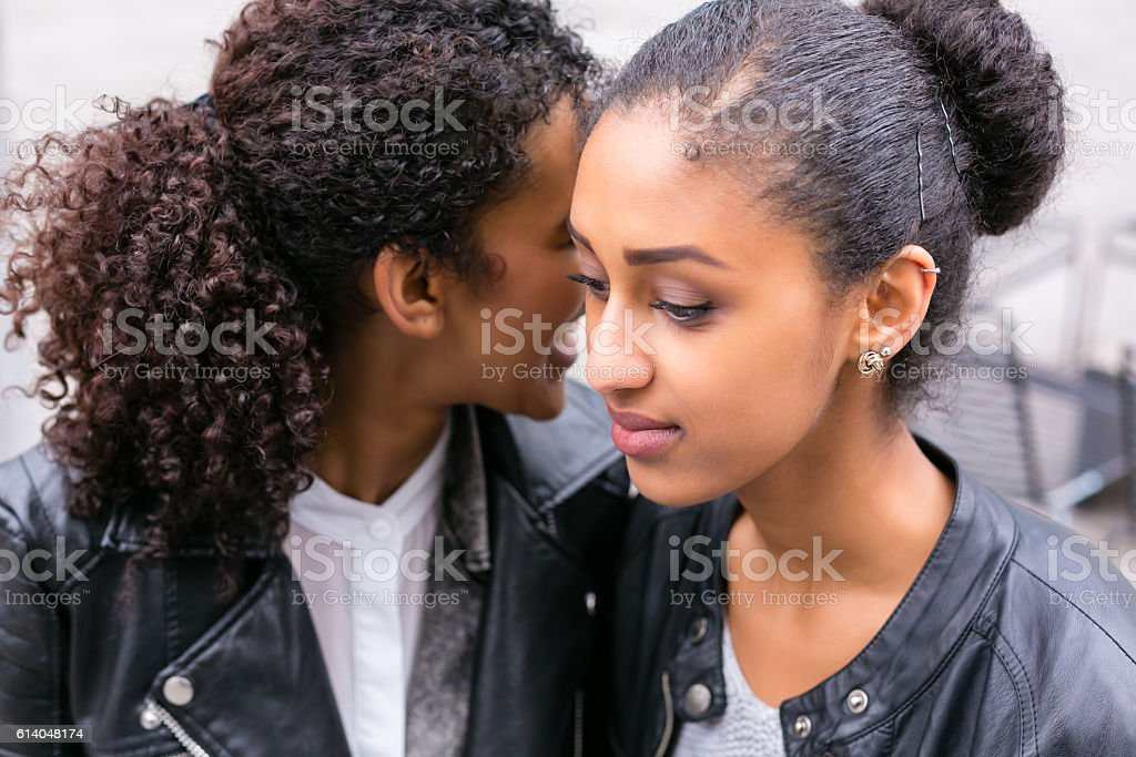 Best friends talking and having fun in park stock photo