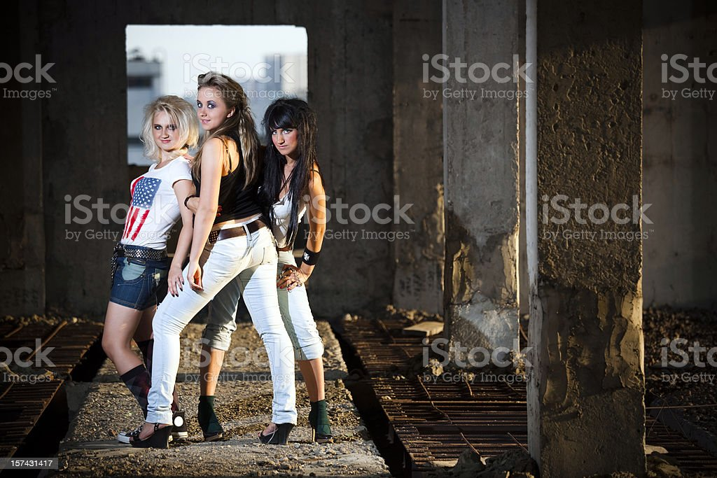 Best friends. Three teenage girls in abandoned building royalty-free stock photo