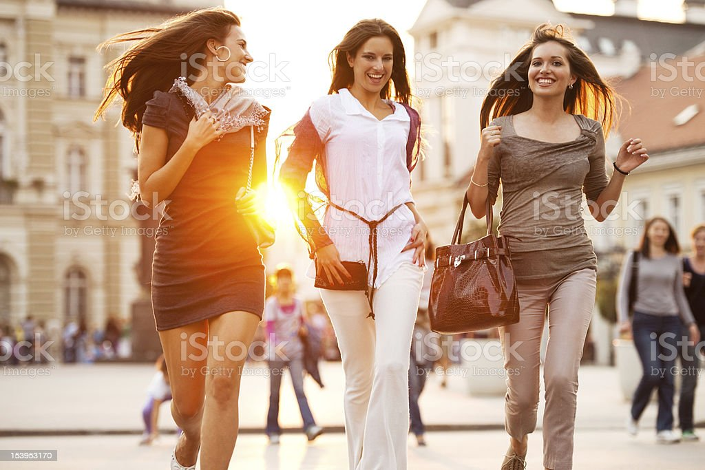 Best friends walking down the streets. royalty-free stock photo