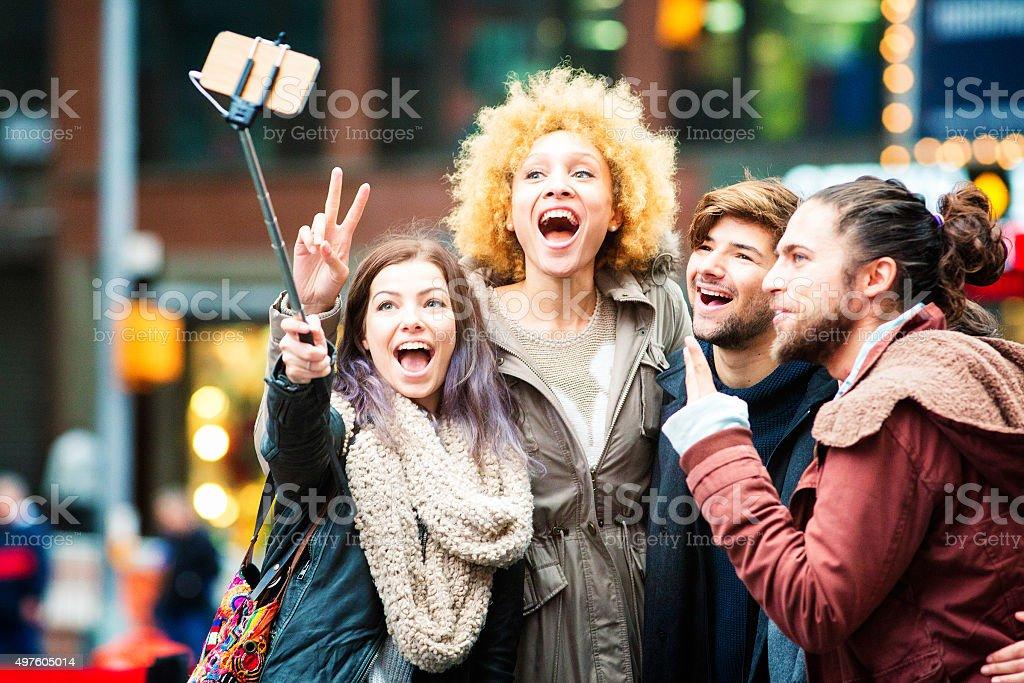 Best group selfie ever using stick in Manhattan stock photo