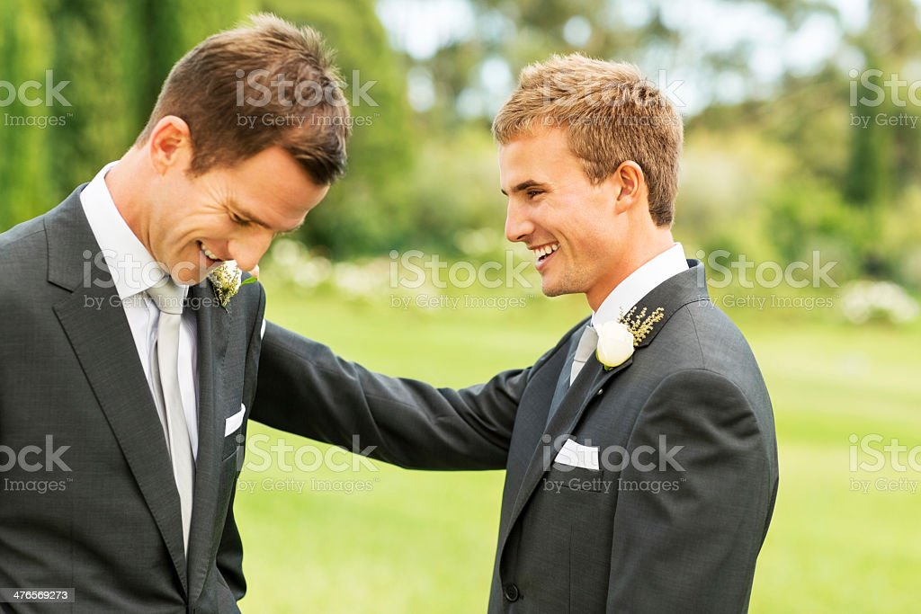 Best Man Looking At Groom In Garden royalty-free stock photo