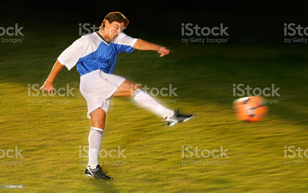 Best soccer player kicking the ball royalty-free stock photo
