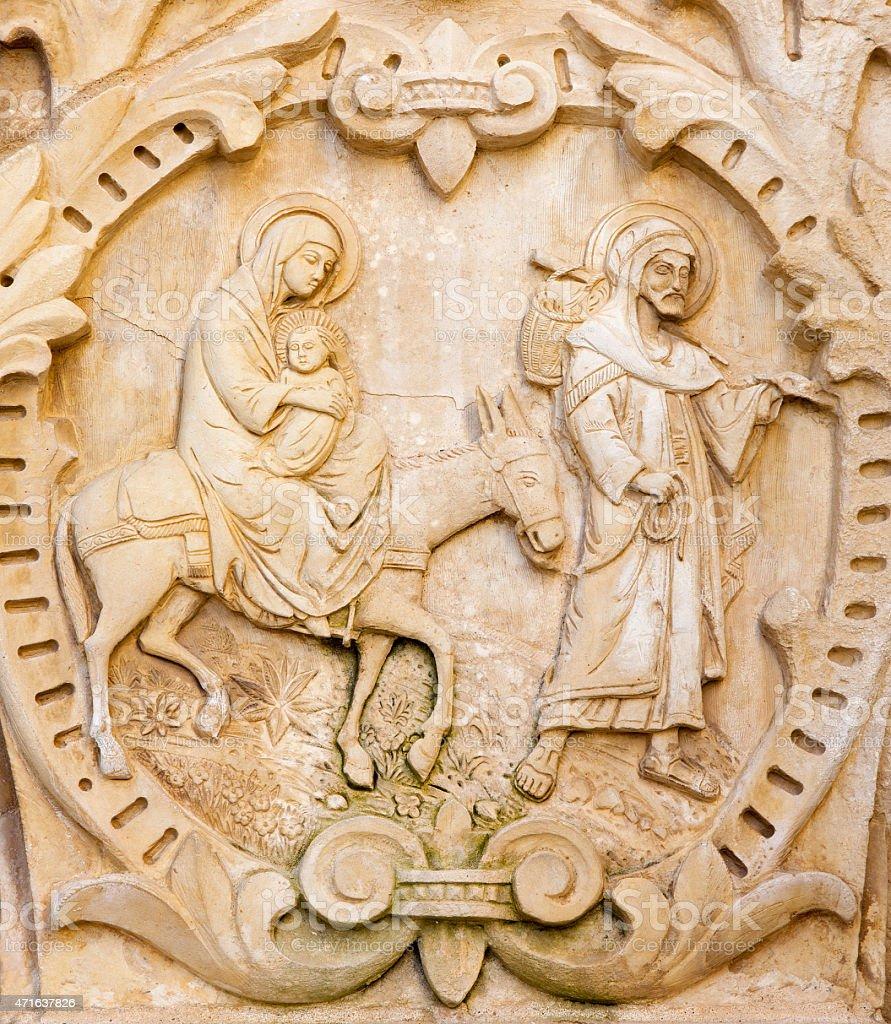 Bethlehem - The flight of Holy family to Egypt relief. stock photo