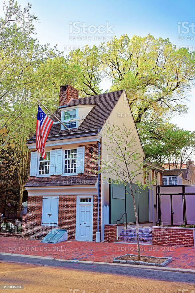Betsy Ross house and Hanging American Flag in Philadelphia stock photo