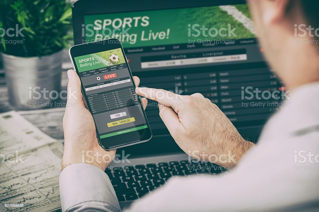 betting bet sport phone gamble laptop concept stock photo