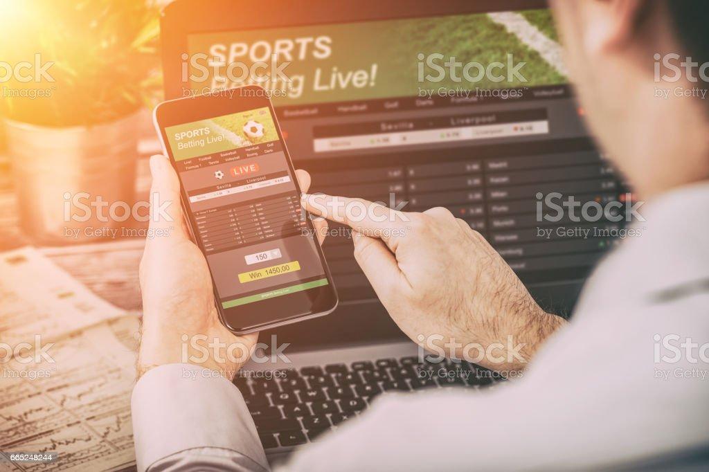 betting bet sport phone gamble laptop concept stock photo