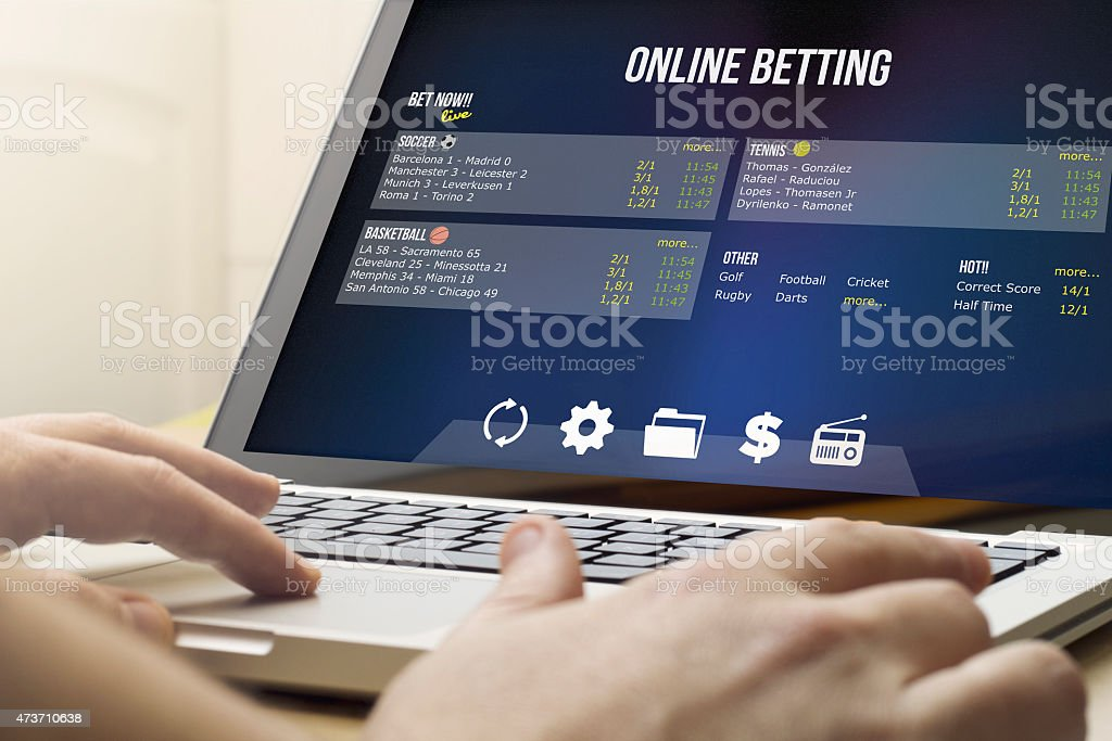 betting online on a laptop stock photo