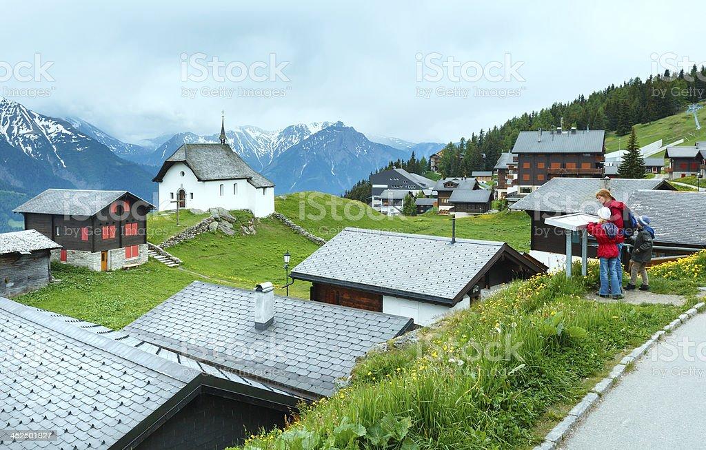 Bettmeralp village summer view (Switzerland) and family. stock photo