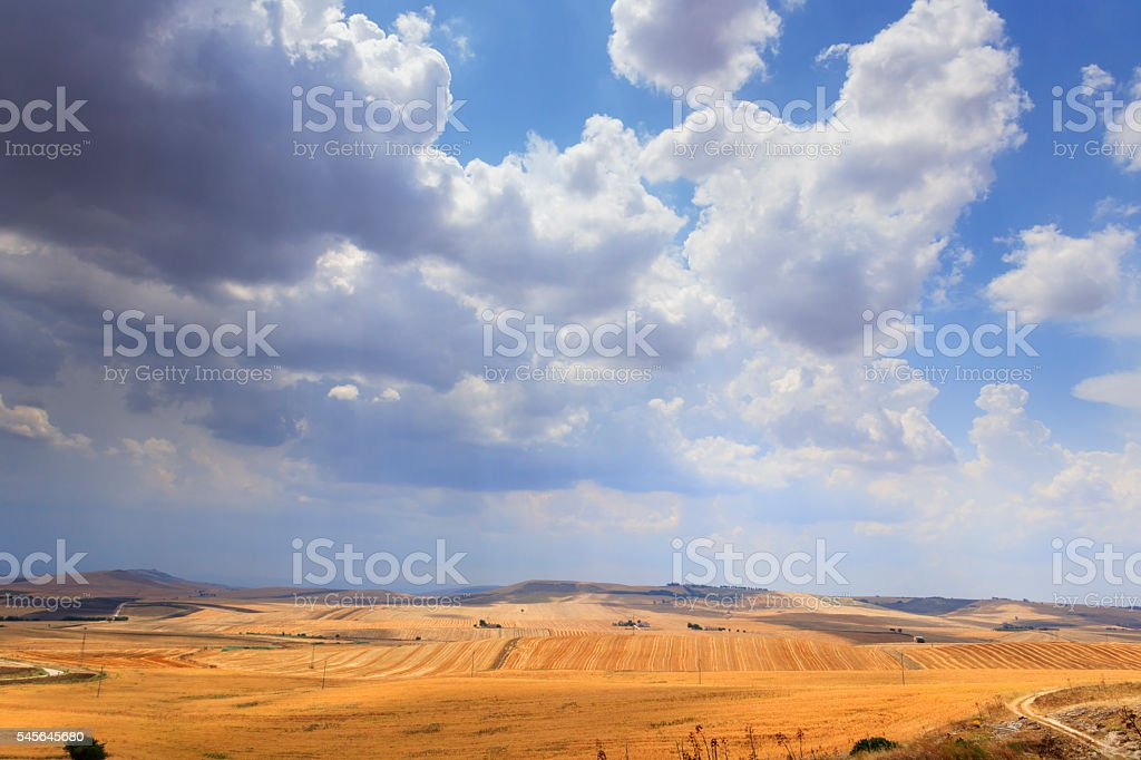 RURAL Between Apulia and Basilicata: harvested fields with farms.Italy. stock photo