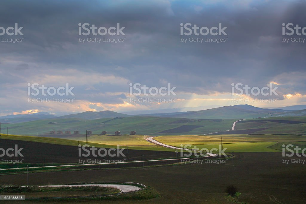 Between Apulia and Basilicata: hills landscape with farmhouses. ITALY stock photo