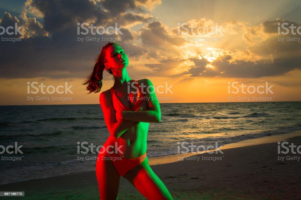 Beuatiful young woman at the beach sunset stock photo