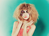 beutiful girl with creative make up like butterfly. Woman in