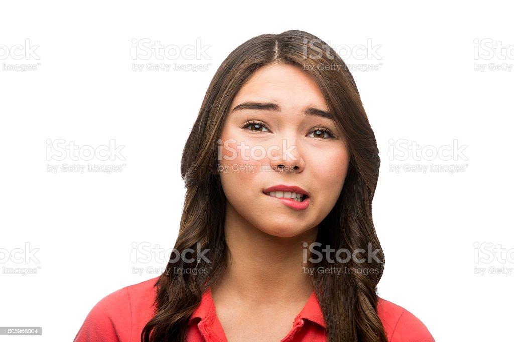 Beutiful young woman biting her lip stock photo