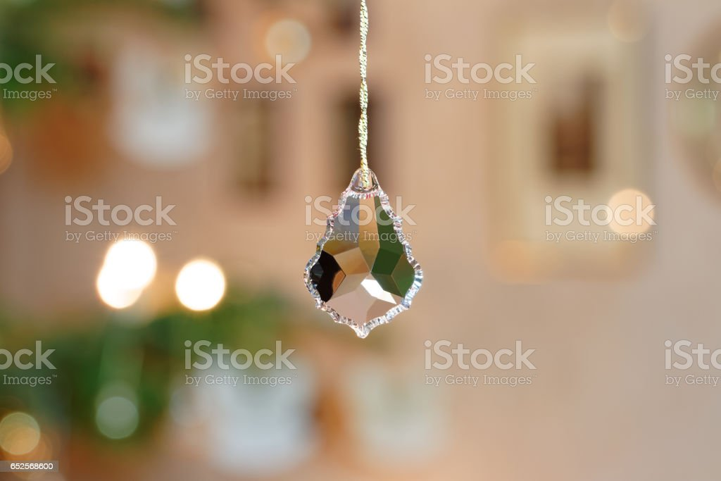 Bevelled Glass Crystal in front of Christmassy Bokeh Background – Foto