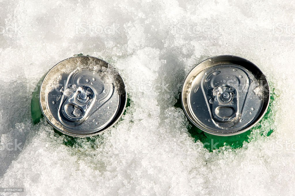 Beverage cans on snow stock photo