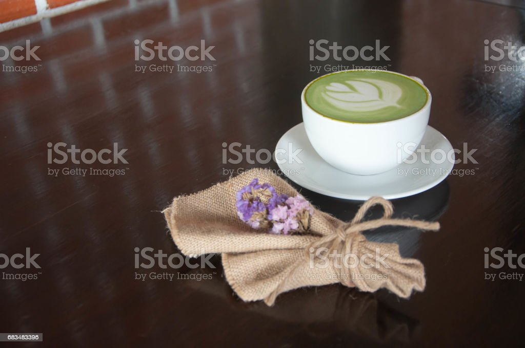 Beverage. hot beverage. Green Tea with milk foam. stock photo