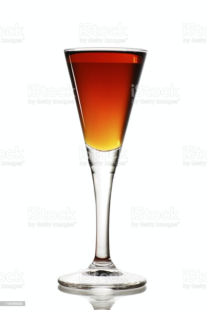 Beverage in a tall flute glass sitting on a white surface stock photo