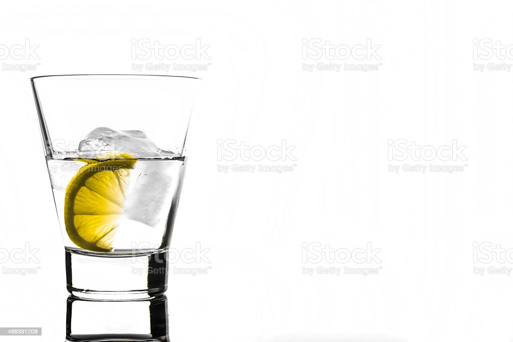Beverage with lemon and ice in glass stock photo
